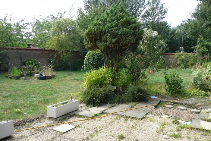 The garden was to have a patio that would link all parts of the house and take you round the plot.