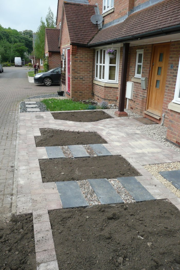 I used driveway setts to define the main routes and a short cut in stepping stones to the parking area too. The client's garden is now clearly defined.