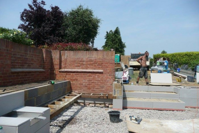 We are using the old walling to tie in with the new landscaping.