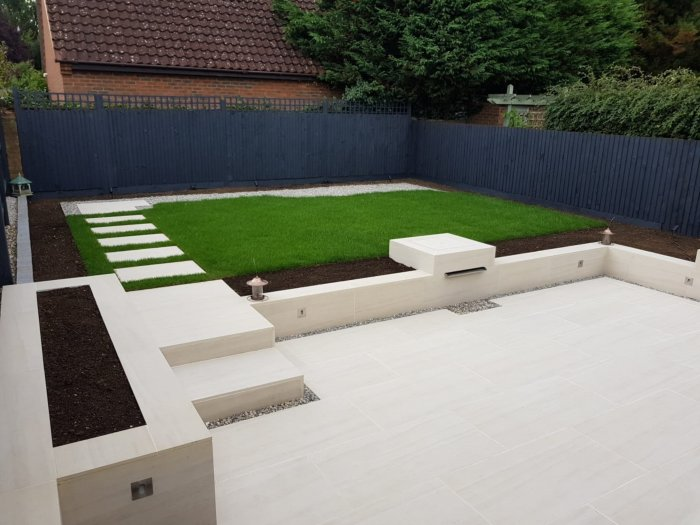 The lines are very simple using paving to create the patios and clad all the new walling too.