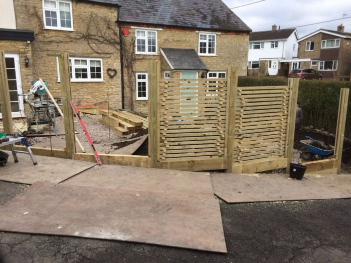 Work under way, new slatted trellis going in which balances privacy with some visibility and light.