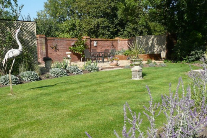 The walled area was very neglected; its now restored as another area to enjoy the sun and a raised vegetable bed to grow crops.