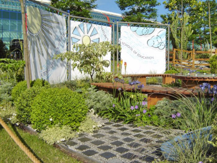 The garden had a backdrop of planting and decorative canvases.