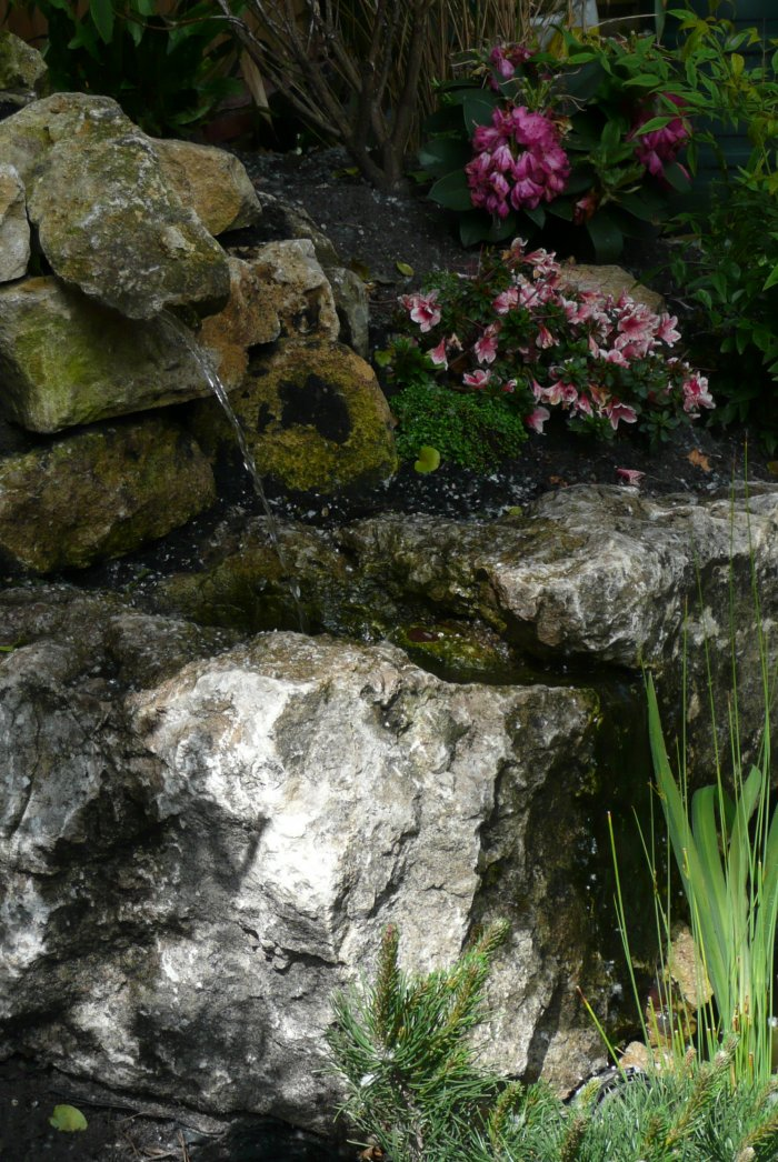 We had a lovely rock which lent itself perfectly to a natural looking simple water feature; the team did a great job creating this space.