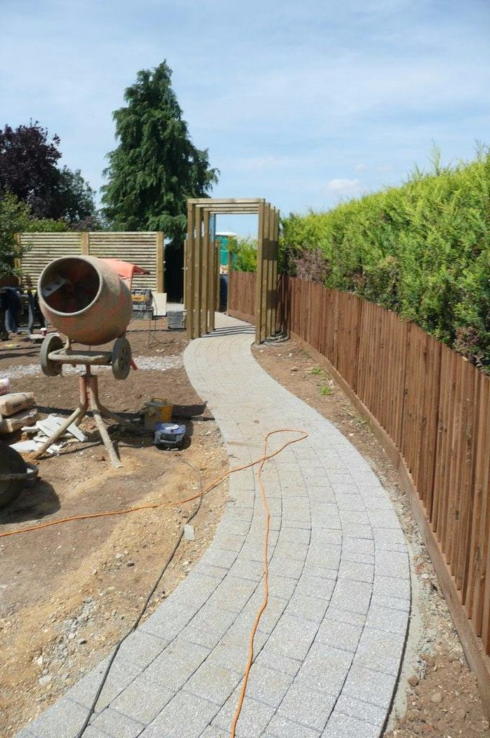 The upper garden area going in with its simple arches.
