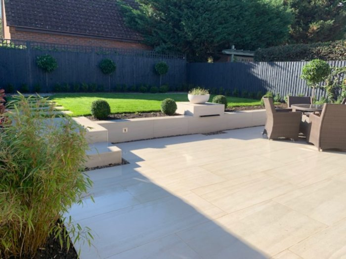 The raised areas help soften the space, the feature topiary trees will grow to add impact.