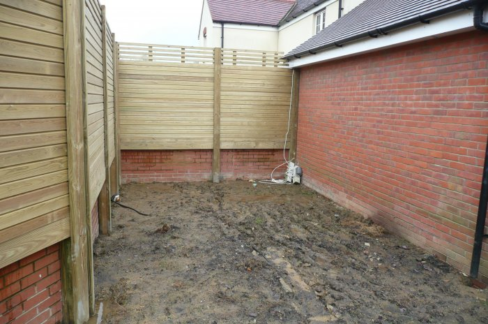 This area had been cleared (a deck from the previous owners) and so was a blank if rather muddy canvas! This area gets the best sun.