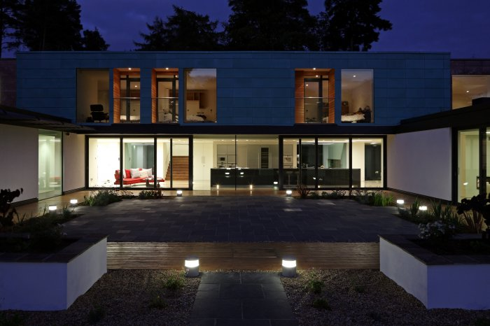 The house at night; the main patio lighting gently complementing the main house.