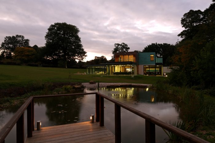 The house at dusk with the jetty, lighting proving very key to the finished garden.