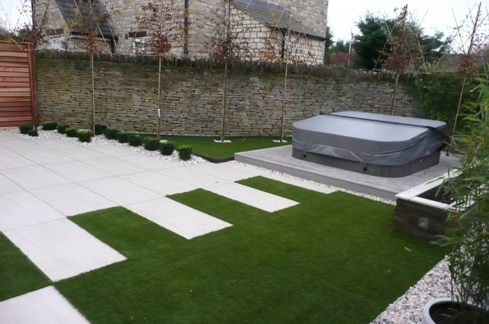 Because its artificial grass we could do interesting details within the paving, this softens the space. It also provides flexibility for use too.