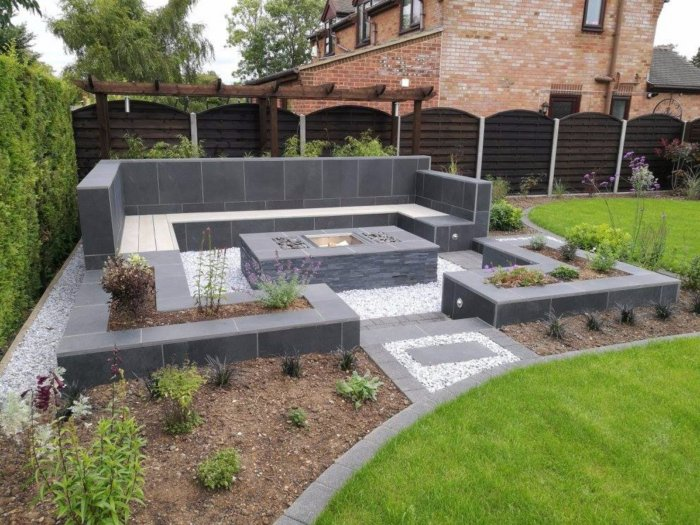 Planting day arrives and all the landscaping is complete; the sunken seating area has its fitted fire pit and will have lots of nice cushions too.