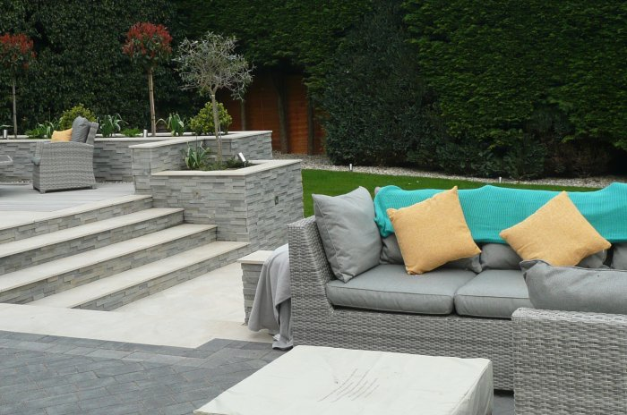 The clients chose beautiful furniture which compliments the landscaping perfectly.