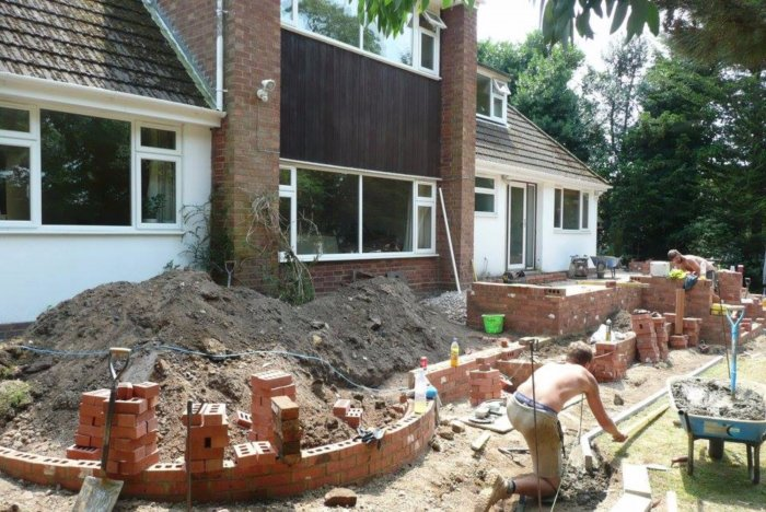 Work underway; low walling used to form a new gravel garden area to the left.