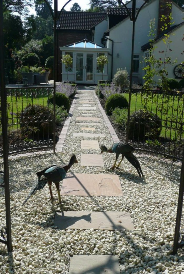 A new path and the new orangery too; with bird like visitors!