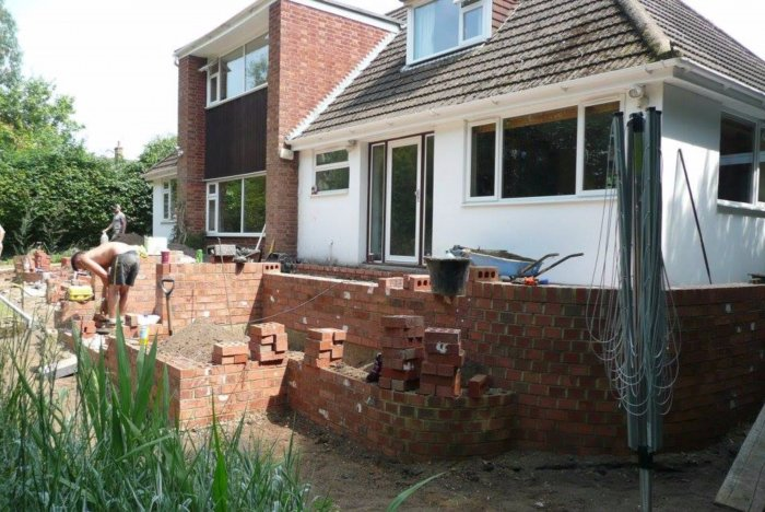 The new patio area, steps and tiered bed (to make the drop safer and softer). You can now walk around to the side of the house all on one level. Lee has done a lovely bit of brick laying to achieve the curve on the wall corners- beautiful!