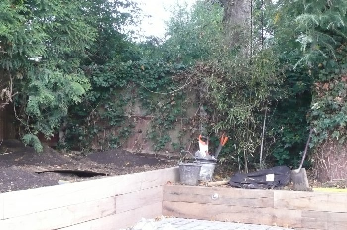 After extensive clearance, work is under way. Raised beds being added in oak sleepers.