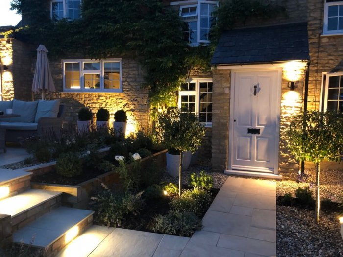 The 4 formal up lit trees will grow to balance with the front door and make this the focal point of the scheme.