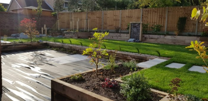 A stepping stone path and an improved flow of paths and routes around the garden means much better access and movement around the whole garden. Raised planting around the lower level will add a feeling of improved depth to the garden.