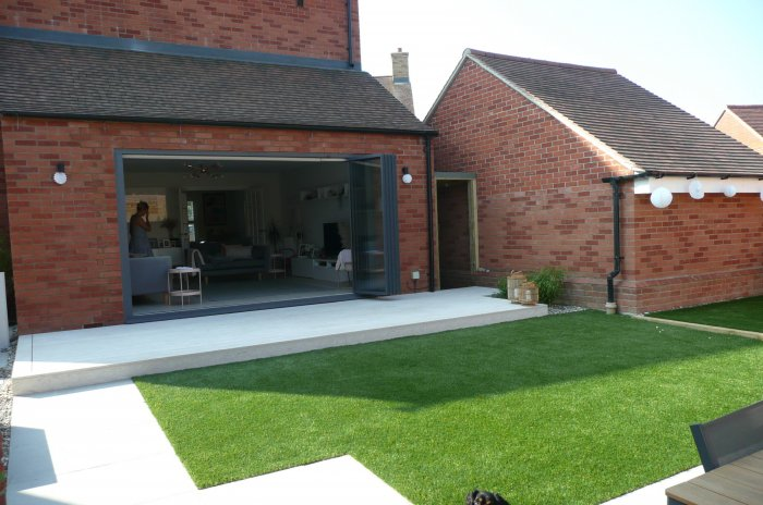It was decided given the size and shady aspect that artificial grass would be the easiest option to keep looking good.