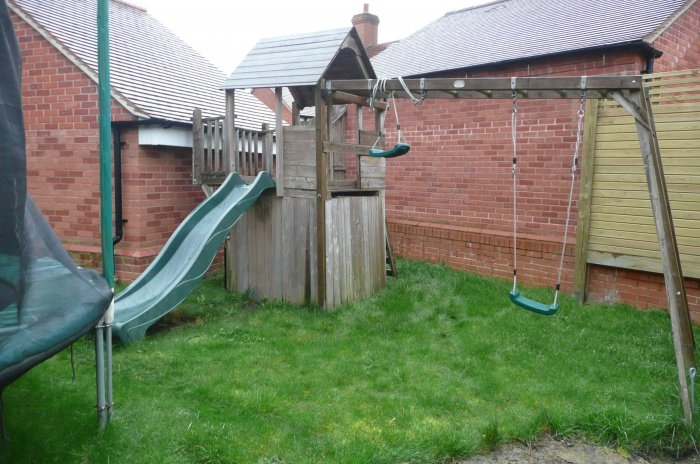 The view from the sunny area across the garden, the play frame was to go...the trampoline originally planned to stay did in fact go too so this offered up much more space.