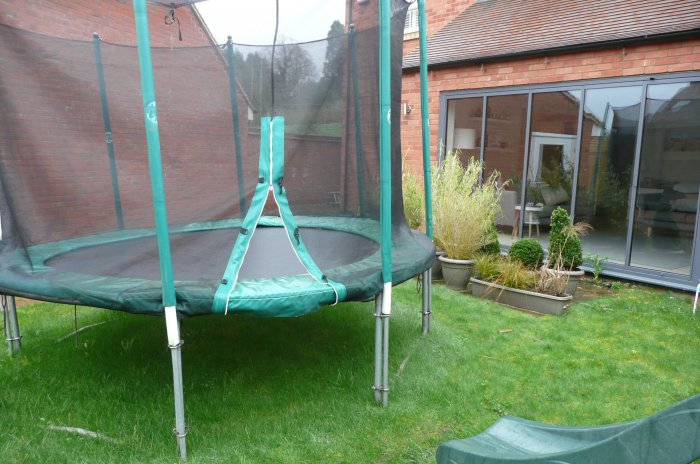 The trampoline was very dominant and the slope meant it could only go in the middle of the old garden.