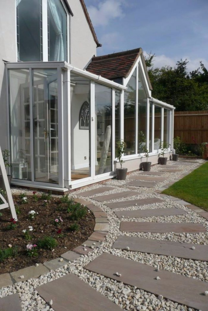 The much softer path really allows the conservatory to stand out.