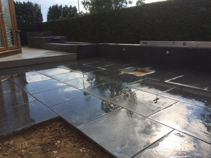 The new patio- a decked area by the conservatory and the new water rill water feature.